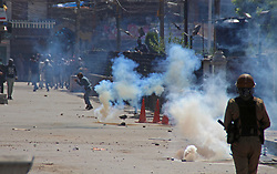 June 16, 2017 - Srinagar, Jammu and Kashmir, India - Kashmiri protesters clash with Indian police in   Srinagar. Police fired dozens of tear smoke shells and pellets to disperse protestors in downtown Srinagar after Friday (Credit Image: © Umer Asif/Pacific Press via ZUMA Wire)