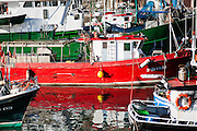 Fishing red boat in San Sebastian harbor (Spain)