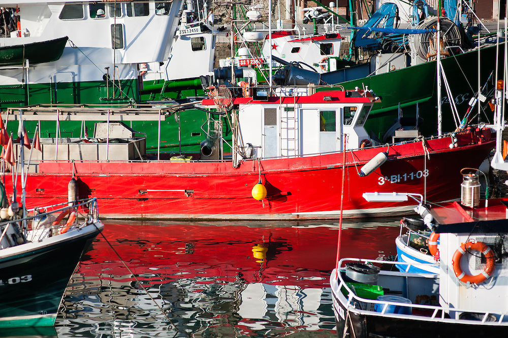 Fishing red boat in San Sebastian harbor (Spain)