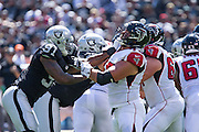 Oakland Raiders linebacker Shilique Calhoun (91) battles at the line of scrimmage against the Atlanta Falcons at Oakland Coliseum in Oakland, Calif., on September 18, 2016. (Stan Olszewski/Special to S.F. Examiner)