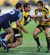 AAron Cruden passes the ball in the tackle of Rene Ranger. Super Rugby - Hurricanes v Blues at Westpac Stadium, Wellington, New Zealand on Friday 6th May 2011. PHOTO: Grant Down / photosport.co.nz