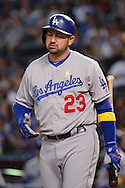 PHOENIX, AZ - SEPTEMBER 17:  Adrian Gonzalez #23 of the Los Angeles Dodgers reacts to a pitch in the first inning against the Arizona Diamondbacks at Chase Field on September 17, 2016 in Phoenix, Arizona. The Dodgers won 6 - 2.  (Photo by Jennifer Stewart/Getty Images)