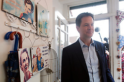 © Licensed to London News Pictures. 13/04/2015. Carshalton, UK. Nick Clegg at the Corner Gallery to hand a picture by a local artist.  Leader of the Liberal Democrats and Deputy Prime Minister Nick Clegg visits Carshalton and Wallington constituency on Monday (13th April) with Lib Dem candidate Tom Brake.  Photo credit : Stephen Simpson/LNP