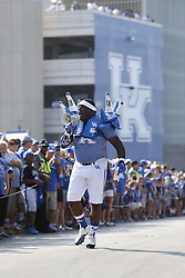 Stanley Williams Sr., rallies the crowd before Kentucky hosted Louisiana-Lafayette , Saturday, Sept. 05, 2015 at Commonwealth Stadium in Lexington. Photo by Jonathan Palmer