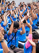 09 DECEMBER 2012 - BANGKOK, THAILAND:  Thai college students participate in anti-corruption pledge and skit during an anti-corruption rally at the Bangkok Art and Culture Centre (BACC). About 1,500 Thai university students from 90 universities across Thailand attended the rally. The latest Corruption Perceptions Index survey by Transparency International listed Thailand at number 88 out of 176 countries surveyed. The level of corruption in Thailand is perceived to be on the same par as Malawi, Swaziland and Zambia. Thailand's ranking slipped from 80 last year. A series of surveys show that Thais increasingly view corruption as acceptable. A recent ABAC (Assumption Business Administration College, the forerunner to Assumption University, one of the most respected private universities in Thailand) poll reported that a majority (63 per cent) of Thai people hold the view that corruption in government is acceptable as long as they also benefit from it. A majority of young people under 20 now hold the same attitude. International Anti-Corruption Day has been observed annually, on the 9th December, since the passage of the United Nations Convention Against Corruption on 31 October 2003.       PHOTO BY JACK KURTZ