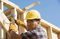 Construction worker using hammer on building