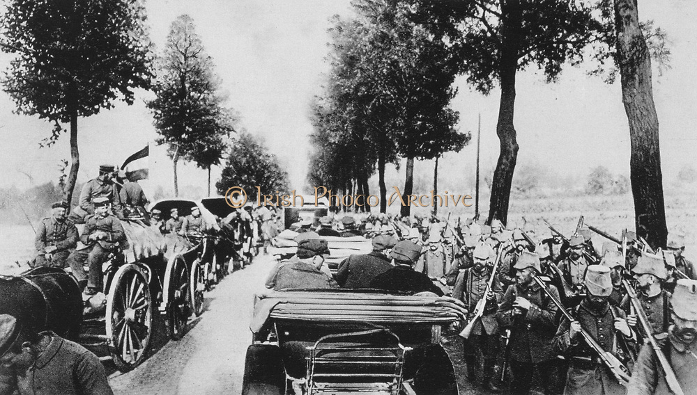 World War I 1914-1918: The high road in wartime, 1915. Left is the German baggage train of horse-drawn carts.  Right, the infantry carrying their rifles and backpacks. Centre, Motor vehicles. Military, Army