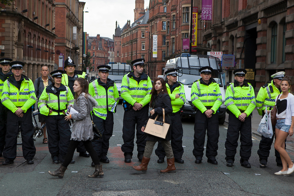 Manchester Police Officer cordon off an area at the TUC demonstration during the 2011 Conservative Party Conference held in Manchester, UK.