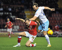Coventry City's Andy Webster fouls Bristol City's Aaron Wilbraham - Photo mandatory by-line: Dougie Allward/JMP - Mobile: 07966 386802 - 10/12/2014 - SPORT - Football - Bristol - Ashton Gate Stadium - Bristol City v Coventry City - Johnstone's Paint Trophy