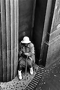 Walking down the steps of the 7 Train in Jackson Heights Queens, I came across this image of an elderly lady  huddled into a corner of a bank building.