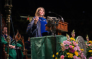 Dr. Risa Whitson, Associate Professor of Geography and the Women's, Gender, and Sexuality Studies Program delivers the graduate commencement address. Photo by Ben Siegel