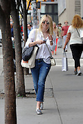 Sept. 8, 2014 - New York City, NY, United States - <br /> <br /> Actress Dakota Fanning's bad hair day<br /> <br /> Actress Dakota Fanning sports a shaggy hair do as she walks in Soho on September 8 2014 in New York City<br /> ©Exclusivepix