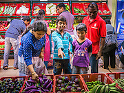 "20 DECEMBER 2012 - KUALA LUMPUR, MALAYSIA:  People shop for fresh vegetables at a market on Jalan Tun Sambanthan, the main street in ""Brickfields,"" the Little India section of Kuala Lumpur, Malaysia. The ""Little India"" section of Kuala Lumpur is also known as ""Brickfields."" The area has recently been renovated and has emerged as a tourist draw. It's within walking distance of KL Stesen Sentral, the Kuala Lumpur central train station.    PHOTO BY JACK KURTZ"
