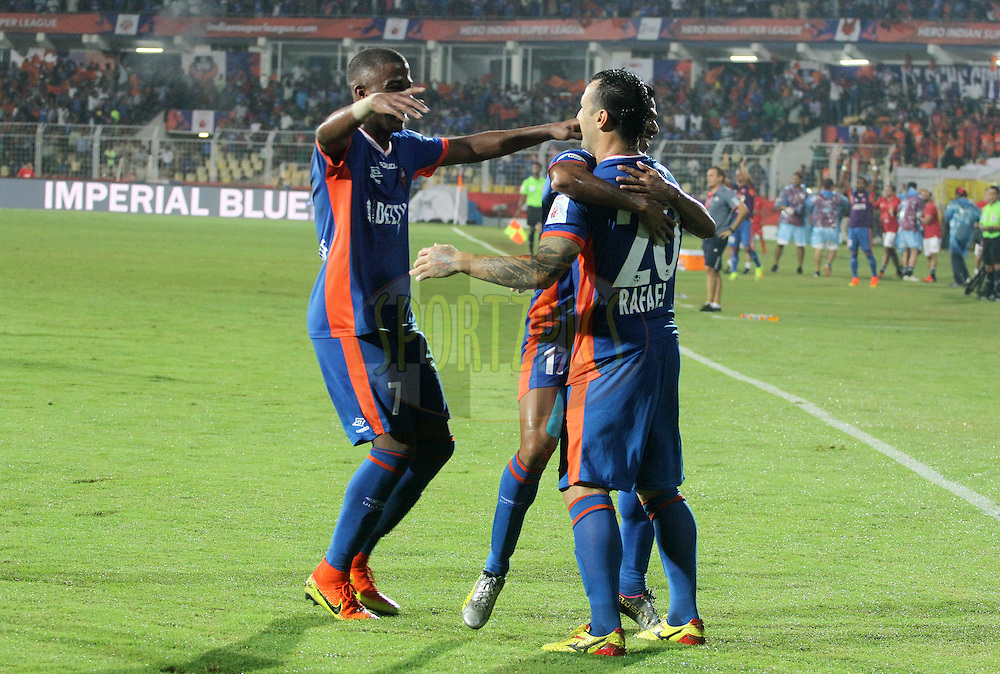 Rafael Coelho of FC Goa celebrates a goal with his teammates during match 8 of the Indian Super League (ISL) season 3 between FC Goa and FC Pune City held at the Fatorda Stadium in Goa, India on the 8th October 2016.<br /> <br /> Photo by Vipin Pawar / ISL/ SPORTZPICS