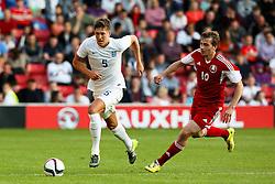 John Stones of England in action - Photo mandatory by-line: Matt McNulty/JMP - Mobile: 07966 386802 - 11/06/2015 - SPORT - Football - Barnsley - Oakwell Stadium - England U21 v Belarus U21 - International Friendly U21s