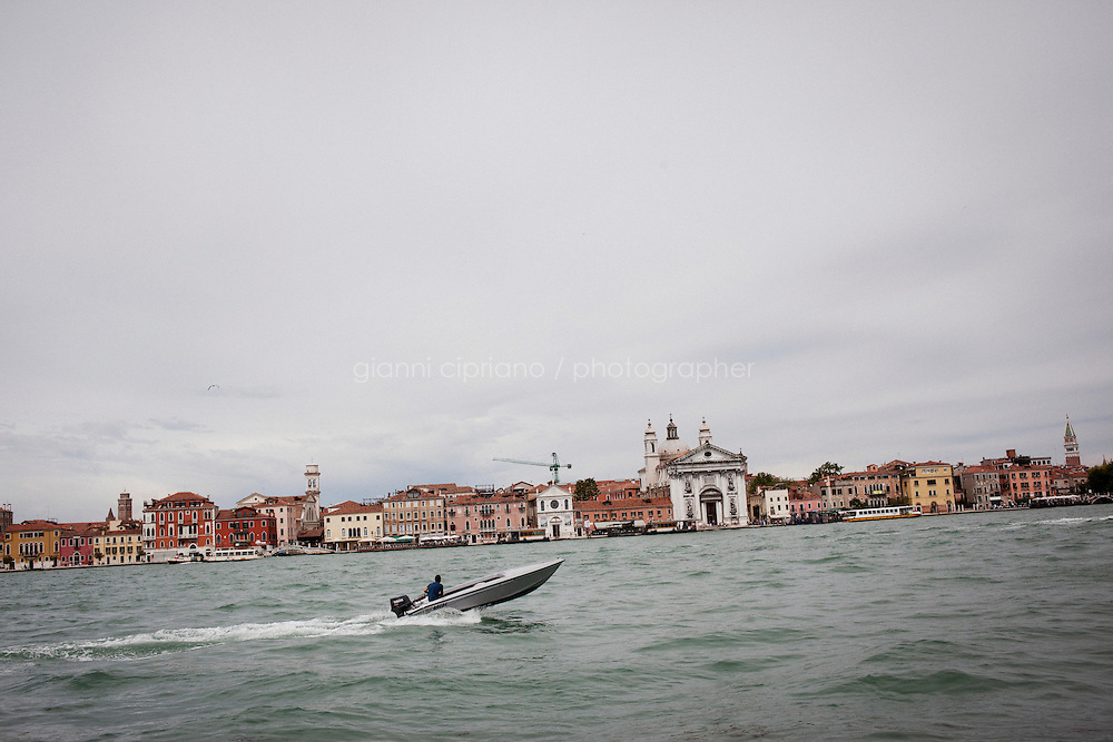 VENICE, ITALY - 1 JUNE 2013: A boat navigates in the Canal della Giudecca in Venice, Italy, on June 1st 2013. <br /> <br /> <br /> The 55th International Art Exhibition of the Venice Biennale takes place in Venice from June 1st to November 24th, 2013 at the Giardini and at the Arsenale as well as in various venues the city. <br /> <br /> Gianni Cipriano for The New York TImes