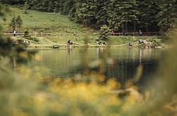 THEMENBILD - arabische Urlaubsgäste und Touristen sitzen direkt am See und genießen die Landschaft. Der Hintersee ist ein kleiner Gebirgssee in 1313 m Höhe im Talschluss des Felbertals in Mittersill. Der Bergsee ist ein Naturdenkmal und wurde unter Schutz gestellt. Der Hintersee gilt als Geheimtipp, Erholungsgebiet und ein Platz, den man gesehen haben muss, aufgenommen am 23. Juni 2019, am Hintersee in Mittersill, Österreich // Arab holiday guests and tourists sit directly at the lake and enjoy the landscape. Hintersee is a small mountain lake 1313 m above sea level at the end of the Felbertal valley in Mittersill. The mountain lake is a natural monument and was placed under protection. The Hintersee is an insider tip, a place you must have seen and a recreation area on 2019/06/23, Hintersee in Mittersill, Austria. EXPA Pictures © 2019, PhotoCredit: EXPA/ Stefanie Oberhauser
