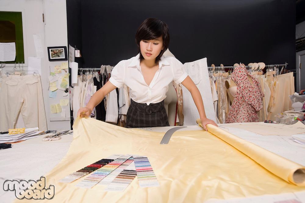 Fashion designer working at desk