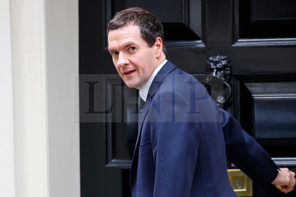 © Licensed to London News Pictures. 13/10/2015. London, UK. Chancellor of Exchequer GEORGE OSBORNE leaving Downing Street after a cabinet meeting on Tuesday, 13 October 2015. According to the official figures by Consumer Prices Index, UK inflation fell to -0.1% in September. Photo credit: Tolga Akmen/LNP