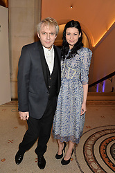 NICK RHODES and NEFER SUVIO at a private view of photographs by David Bailey entitled 'Bailey's Stardust' at the National Portrait Gallery, St.Martin's Place, London on 3rd February 2014.
