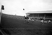 W R Hunter, Ireland, tackles a Welshman, forcing him to kick wildly for touch,..Irish Rugby Football Union, Ireland v Wales, Five Nations, Landsdowne Road, Dublin, Ireland, Saturday 17th November, 1962,.17.11.1962, 11.17.1962,..Referee- J A E Taylor, Scottish Rugby Union, ..Score- Ireland 3 - 3 Wales, ..Irish Team, ..T J Kiernan,  Wearing number 15 Irish jersey, Full Back, University college Cork Football Club, Cork, Ireland,  ..W R Hunter, Wearing number 14 Irish jersey, Right Wing, C I Y M S Rugby Football Club, Belfast, Northern Ireland, ..A C Pedlow, Wearing number 13 Irish jersey, Right Centre,  C I Y M S Rugby Football Club, Belfast, Northern Ireland, ..M K Flynn, Wearing number 12 Irish jersey, Left Centre, Wanderers Rugby Football Club, Dublin, Ireland, ..N H Brophy, Wearing number 11 Irish jersey, Left wing, London Irish Rugby Football Club, Surrey, England, ..M A English, Wearing number 10 Irish jersey, Stand Off, Landsdowne Rugby Football Club, Dublin, Ireland, ..J C Kelly, Wearing number 9 Irish jersey, Scrum Half, University College Dublin Rugby Football Club, Dublin, Ireland, ..M P O'Callaghan, Wearing number 1 Irish jersey, Forward, Sundays Well Rugby Football Club, Cork, Ireland, ..A R Dawson, Wearing number 2 Irish jersey, Forward, Wanderers Rugby Football Club, Dublin, Ireland, ..P J Dwyer, Wearing number 3 Irish jersey, Forward, University College Dublin Rugby Football Club, Dublin, Ireland, ..W J McBride, Wearing number 4 Irish jersey, Forward, Ballymena Rugby Football Club, Antrim, Northern Ireland,..W A Mulcahy, Wearing number 5 Irish jersey, Captain of the Irish team, Forward, Bective Rangers Rugby Football Club, Dublin, Ireland,  ..P J A O'Sullivan, Wearing  Number 6 Irish jersey, Forward, Galwegians Rugby Football Club, Galway, Ireland, ..C J Dick, Wearing number 8 Irish jersey, Forward, Ballymena Rugby Football Club, Antrim, Northern Ireland, ..M D Kiely, Wearing number 7 Irish jersey, Forward, Landsdowne Rugby Football Club, Dublin, Irelan