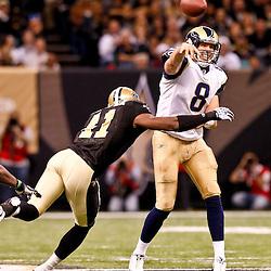December 12, 2010; New Orleans, LA, USA; St. Louis Rams quarterback Sam Bradford (8) throws as New Orleans Saints safety Roman Harper (41) pressures during the second half at the Louisiana Superdome. Mandatory Credit: Derick E. Hingle-US PRESSWIRE