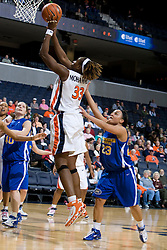 Virginia center Aisha Mohammed (33) shoots past Morehead St. guard Anitha Smith-Williams (23).  The Virginia Cavaliers women's basketball team defeated the Morehead State Eagles 88-43 at the John Paul Jones Arena in Charlottesville, VA on February 4, 2008.