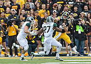 October 6 2013: Iowa Hawkeyes quarterback Jake Rudock (15) throws over the top of Michigan State Spartans safety Kurtis Drummond (27) during the first quarter of the NCAA football game between the Michigan State Spartans and the Iowa Hawkeyes at Kinnick Stadium in Iowa City, Iowa on October 6, 2013. Michigan State defeated Iowa 26-14.