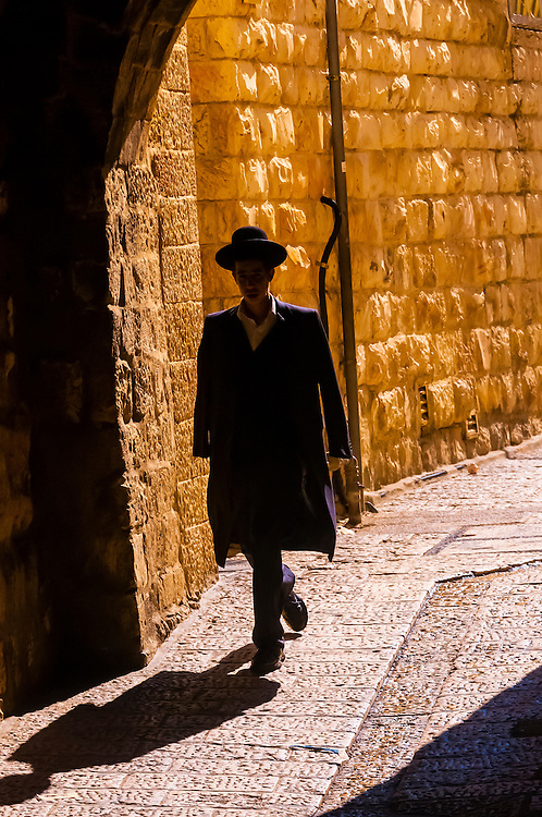 A Hassidic Jew walking down a street in the Old City, Jerusalem, Israel.