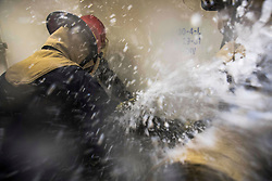 U.S. Sailors assigned to Repair Station Five aboard the amphibious transport dock ship USS San Diego (LPD 22) participate in damage control training held in the ship's forward decontamination station in the South China Sea Aug. 24, 2017. San Diego, part of the America Amphibious Ready Group, with embarked 15th Marine Expeditionary Unit, is operating in the Indo-Asia Pacific region to strengthen partnerships and serve as a ready-response force for any type of contingency. (U.S. Navy photo by Mass Communication Specialist 3rd Class Justin A. Schoenberger)  Please note: Fees charged by the agency are for the agency's services only, and do not, nor are they intended to, convey to the user any ownership of Copyright or License in the material. The agency does not claim any ownership including but not limited to Copyright or License in the attached material. By publishing this material you expressly agree to indemnify and to hold the agency and its directors, shareholders and employees harmless from any loss, claims, damages, demands, expenses (including legal fees), or any causes of action or allegation against the agency arising out of or connected in any way with publication of the material.