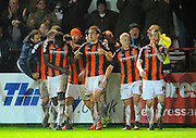 Goal.  Luton celebrate their injury time winning goal during the Sky Bet League 2 match between Exeter City and Luton Town at St James' Park, Exeter, England on 19 December 2015. Photo by Graham Hunt.