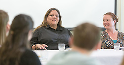 Alex Wilson, Associate Professor and the Academic Director of the Aboriginal Education Research Centre at the University of Saskatchewan, talks with students while visiting campus for Earth Day at PLU on Tuesday, April 19, 2016. (Photo: John Froschauer/PLU)