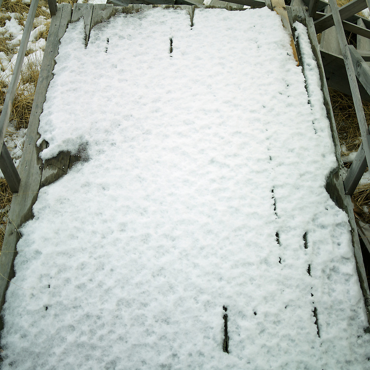 Snow on part of the deconstructed beach stairs