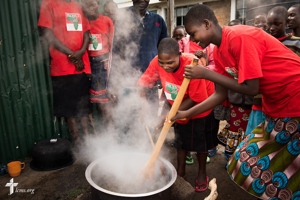 Young ladies cook ugali at the Tumaini ELCK (Evangelical Lutheran Church in Kenya) Project 24 site on Sunday, Oct. 18, 2015, in Kisumu, Kenya. LCMS Communications/Erik M. Lunsford