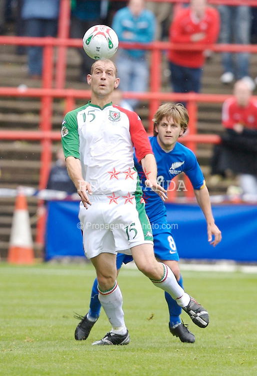 Wrexham, Wales - Saturday, May 26, 2007: Wales' Steve Evans and New Zealand's Chris James during the International Friendly match at the Racecourse Ground. (Pic by David Rawcliffe/Propaganda)