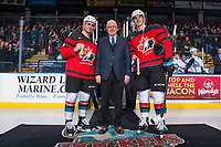 KELOWNA, BC - JANUARY 17: Kelowna Rockets' General Manger Bruce Hamilton stands on the ice between Dillon Dube #19 and Cal Foote #25 of the Kelowna Rockets to acknowledge the gold medal win at the World Jr. Hockey Championships at Prospera Place on January 17, 2018 in Kelowna, Canada. (Photo by Marissa Baecker/Getty Images)