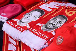 Arsenal scarves outside the stadium featuring Mesut Ozil and Alexandre Lacazette