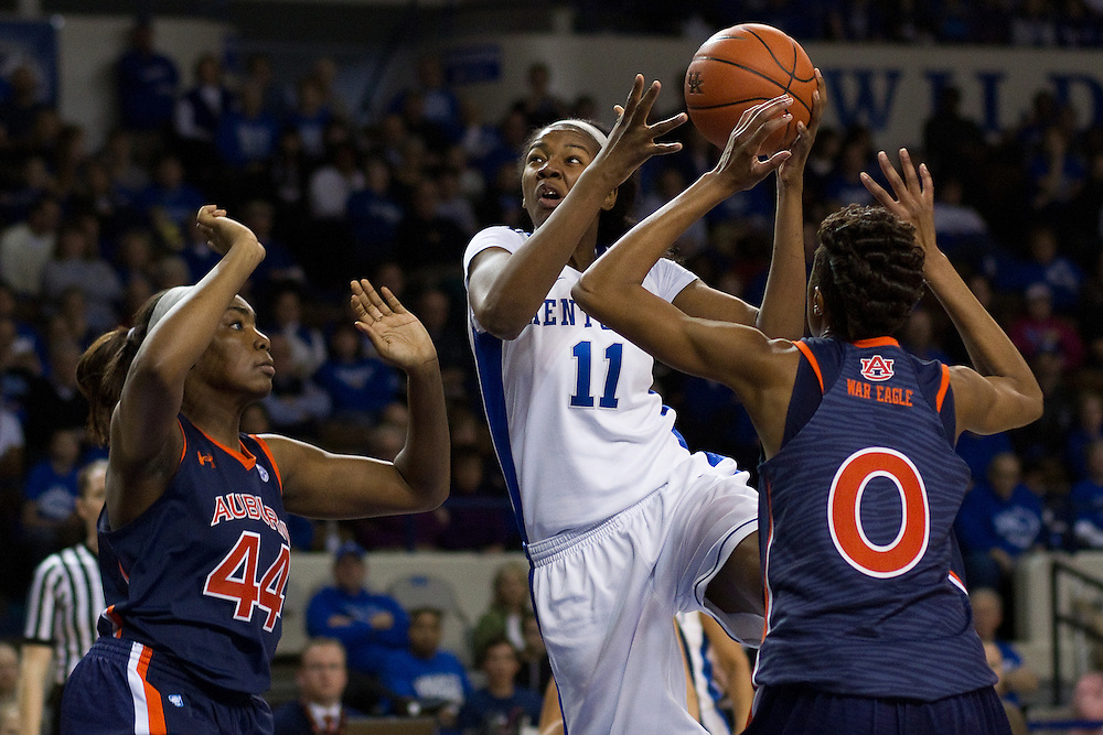 UK center DeNesha Stallworth, center, drives the lane with pressure from Auburn forward/center Tra'Cee Tanner, left, and guard Hasina Muhammad in the first half. The University of Kentucky Women hosted Auburn University, Sunday, Jan. 20, 2013 at Memorial Coliseum in Lexington. Photo by Jonathan Palmer