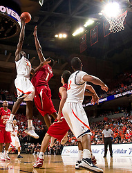 Virginia guard/forward Mamadi Diane (24) shoots over Maryland forward Landon Milbourne (1).  The Virginia Cavaliers defeated the Maryland Terrapins 68-63 at the John Paul Jones Arena on the Grounds of the University of Virginia in Charlottesville, VA on March 7, 2009.