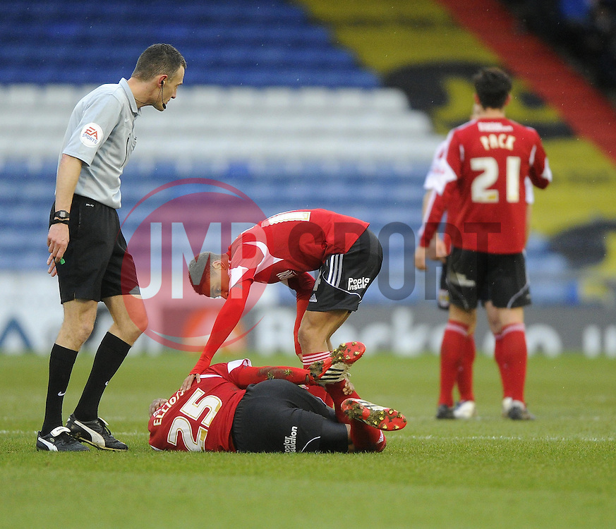 Bristol City's Marvin Elliott lies injured - Photo mandatory by-line: Joe Meredith/JMP - Tel: Mobile: 07966 386802 08/02/2014 - SPORT - FOOTBALL - Oldham - Boundary Park - Oldham Athletic v Bristol City - Sky Bet League One