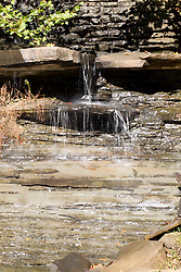 09 October 2013: A small water fall is formed by water flowing over the spillway of Strahl Lake into Strahl Creek.  Brown County State Park, Brown County Indiana.<br /> <br /> This image was produced in part utilizing High Dynamic Range (HDR) processes.  It should not be used editorially without being listed as an illustration or with a disclaimer.  It may or may not be an accurate representation of the scene as originally photographed and the finished image is the creation of the photographer. <br /> <br /> This image was produced in part utilizing High Dynamic Range (HDR) processes.  It should not be used editorially without being listed as an illustration or with a disclaimer.  It may or may not be an accurate representation of the scene as originally photographed and the finished image is the creation of the photographer.