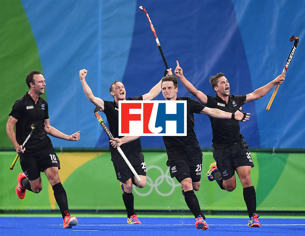 New Zealand's Shea McAleese (2nd R) celebrates his team's second goal during the men's quarterfinal field hockey Germany vs New Zealand match of the Rio 2016 Olympics Games at the Olympic Hockey Centre in Rio de Janeiro on August 14, 2016. / AFP / MANAN VATSYAYANA        (Photo credit should read MANAN VATSYAYANA/AFP/Getty Images)