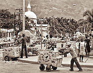 Street scene in Rue Bonne Foi, bustling with activity and the then famous Red Rose Ice Cream, in downtown Port-au-Prince