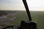 Nederland, Noord-Holland, Hilversum, 15-02-2007; luchtfoto (25 procent toeslag); vliegveld voor de burgerluchtvaart, met landings- en startbaan op gras; het veld wordt veel gebruikt door zweefvliegtuigjes; gefotografeerd door plexiglas cockpit helikopter.luchtfoto (toeslag); aerial photo (additional fee required); .foto Siebe Swart / photo Siebe Swart