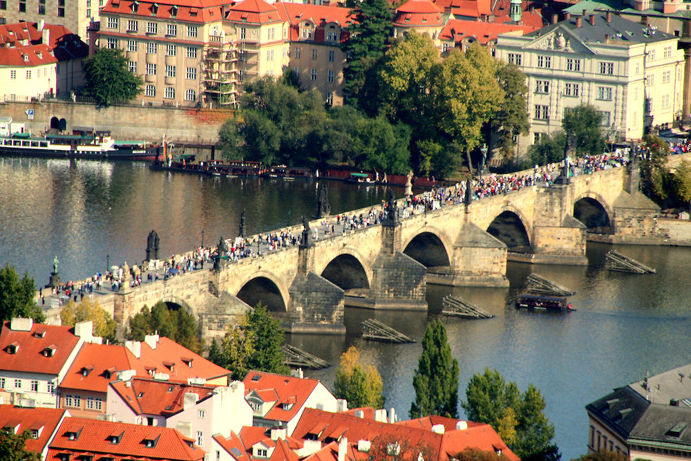 The Charles Bridge  (Karlův Most)  across the Vltava river in Prague, Czech Republic.  Construction started in 1357 under King Charles IV, and finished in the beginning of the 15th century.