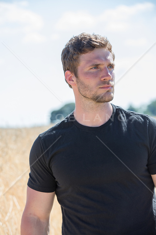 good looking man with blue eyes and brown hair outdoors
