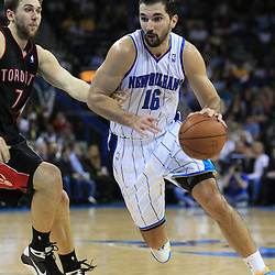 06 February 2009: New Orleans Hornets forward Peja Stojakovic (16) drives past Toronto Raptors center Andrea Bargnani (7) during a 101-92 win by the New Orleans Hornets over the Toronto Raptors at the New Orleans Arena in New Orleans, LA.
