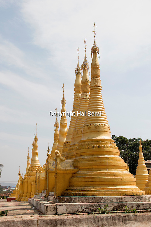 Gold and white Shan style stupas in the Nget Pyaw Taw Pagoda<br /> Pindaya Caves,Myanmar