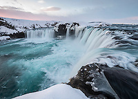 The Goðafoss waterfalls are located in the Mývatn district of North-Central Iceland. The water of the river Skjálfandafljót falls from a height of 12 meters over a width of 30 meters.