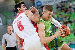 Edo Muric of Slovenia and Arsalan Kazemi Naeini of Iran during basketball match in the context of Telemach tournament between National Teams of Slovenia and Iran on August 21, 2014 in SRC Stozice, Ljubljana, Slovenia. Photo by Urban Urbanc / Sportida.com